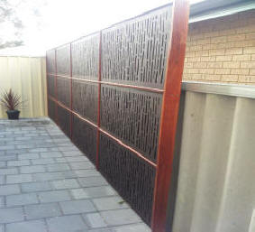 colourbond fencing can also be screened and disguised using modular screen panels this client in applecross wanted to enhance the look of their damaged